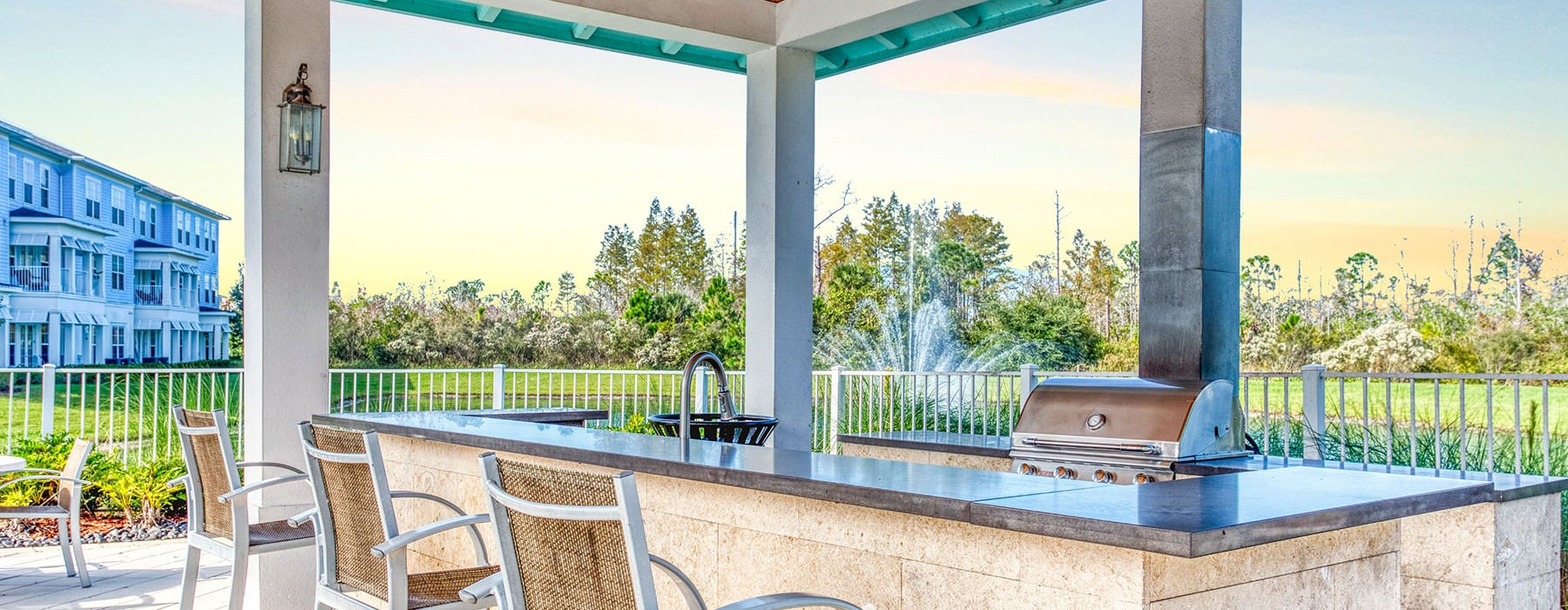 outdoor bar area with many seats and easy access to nearby grills and pool area