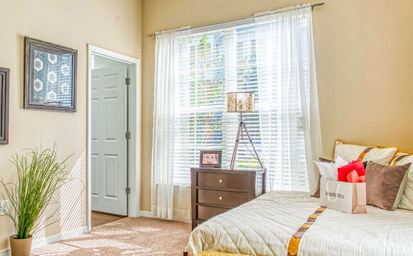 bedroom with a large window, open space and easy access to the hallway
