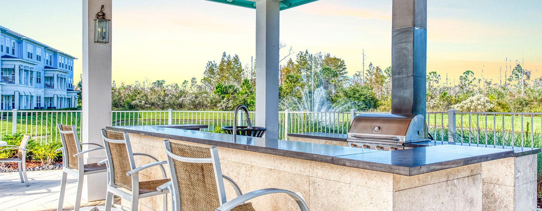 grill area and bar seating in large open outdoor space